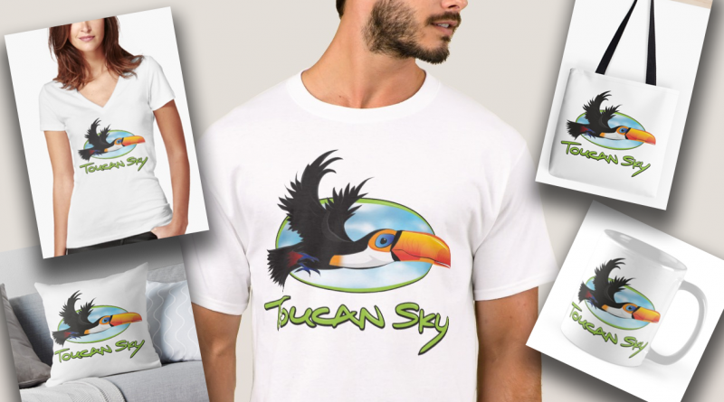 A photo of ToucanSky merchandise. Shirts, bags, mugs, pillows.