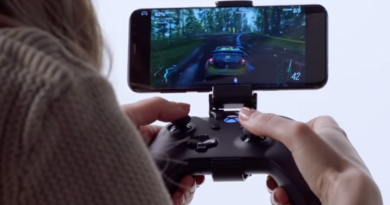 A photo of a woman playing a video game using on her phone using an xbox controller
